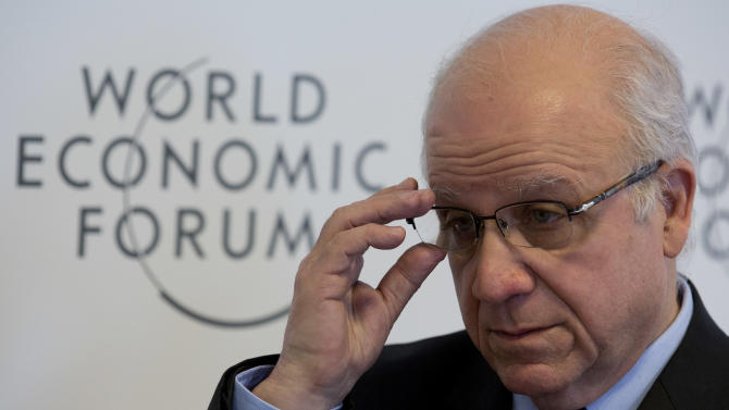 Algerian foreign minister Mourad Medelci adjusts his glasses during an interview with the Associated Press at the 43rd Annual Meeting of the World Economic Forum, WEF, in Davos, Switzerland, Friday, Jan. 25, 2013. (AP Photo/Anja Niedringhaus)