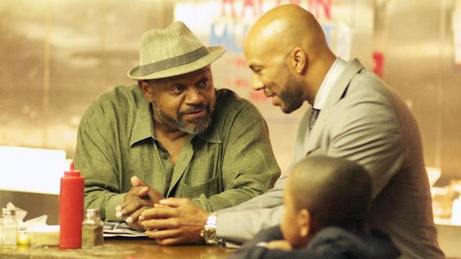 "This film image released by Indomina shows Charles S. Dutton, left, and Common in a scene from ""Luv."" (AP Photo/Indomina, Bill Gray)"