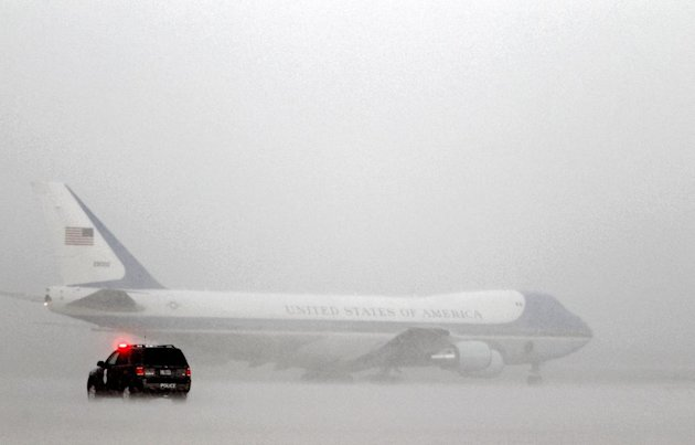 Air Force One, with President Barack Obama aboard, taxis on the runway under a heavy rain before departing from Andrews Air Force Base, Md., Wednesday, Sept. 5, 2012, en route to Charlotte, N.C. for the Democratic National Convention. ( AP Photo/Jose Luis Magana)