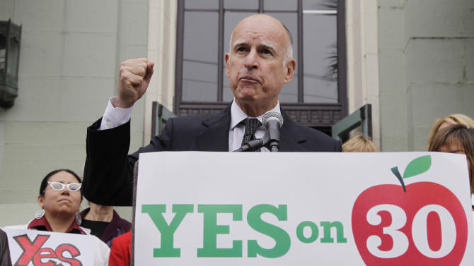 Calif. Gov. Jerry Brown gestures as he campaigns for Proposition 30 at James Lick Middle School in San Francisco, Wednesday, Aug. 22, 2012. As Brown kicked off his campaign for Proposition 30 last week, he sought to emphasize that most of the revenue from the tax increases would come from Californians who are among the wealthiest; an extra $4,500 a year for millionaires, he said. (AP Photo/Paul Sakuma)