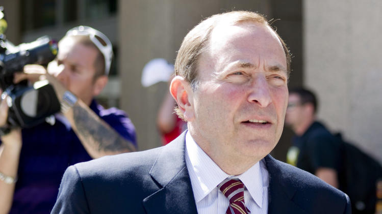 NHL commissioner Gary Bettman leaves the NHLPA offices in Toronto on Wednesday, Aug. 22, 2012. Negotiations continue between the NHL and the NHLPA over collective bargaining as both sides try to avoid a potential lockout. (AP Photo/The Canadian Press, Chris Young)