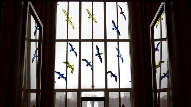 """This photo taken Feb. 19, 2013 shows stained glass birds making up the installation """"Migration,"""" by artist Trondur Patursson, part of """"Nordic Cool,"""" an international festival being held at the Kennedy Center in Washington. More than 700 artists from Denmark, Finland, Iceland, Norway and Sweden, as well as Greenland, the Faroe Islands and the Aland Islands will present their work in theater, dance, music, visual arts, design, film, architecture and cuisine. (AP Photo/Jacquelyn Martin)"""