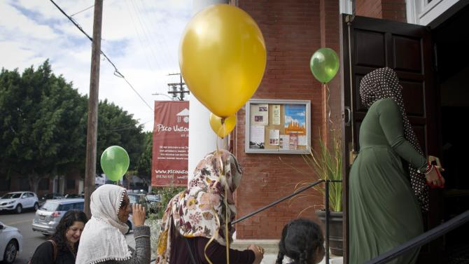 Muslim women arrive for the prayer service at the Women's Mosque in downtown Los Angeles