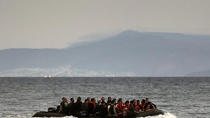 A dingy with Afghan immigrants crosses from Turkey to Greece