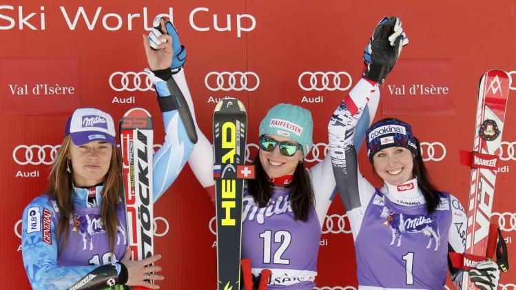 irst placed Kaufmann-Abderhalden of Switzerland, second placed Maze of Slovenia and third placed Huetter of Austria pose after the Women's World Cup Downhill skiing race in Val d'Isere