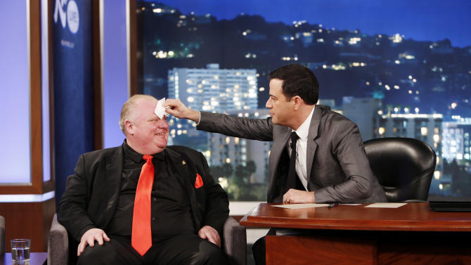 "This March 3, 2014 image released by ABC shows Toronto Mayor Rob Ford, left, having his forehead wiped by host Jimmy Kimmel on the late night talk show ""Jimmy Kimmel Live,"" in Los Angeles. Ford laughed off Jimmy Kimmel's suggestion that he get help for his drinking problem and was reported to be upset about his appearance on the late-night TV talk show. Ford's appearance Monday night on ""Jimmy Kimmel Live"" in Los Angeles was the culmination of months of wooing by the talk-show host to get Ford to appear as a guest. (AP Photo/ABC, Randy Holmes)"