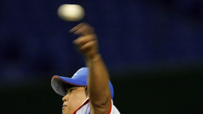 FILE - In this March 6, 2009, file photo, South Korea starter Ryu Hyun-jin pitches against Taiwan during the first inning of a World Baseball Classic game at the Tokyo Dome in Tokyo. The Los Angeles Dodgers have bid nearly $26 million for a chance to sign Ryu, the Hanwha Eagles of the Korea Baseball Organization said Saturday, Nov. 10, 2012. (AP Photo/Shizuo Kambayashi, File)