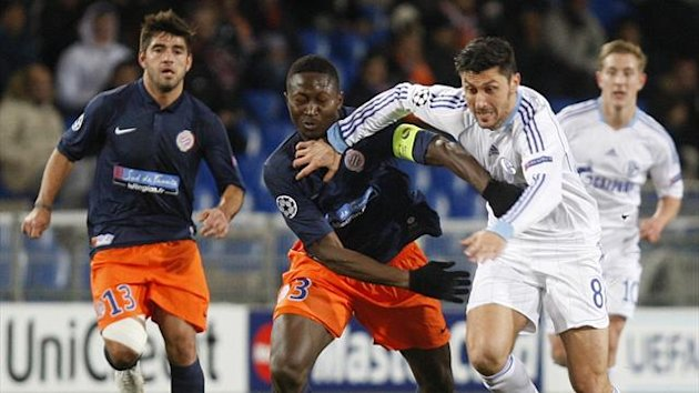 Montpellier's Mapou Yanga-Mbiwa (L) challenges Schalke 04's Ciprian Marica during their Champions League  match at Stade de la Mosson stadium in Montpellier