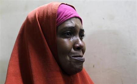 Suspected Somali illegal migrant arrested in police swoop cries as she prepares to be processed for deportation at holding station in Nairobi