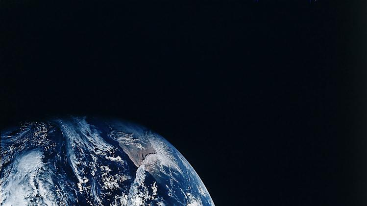 """FILE - This Dec. 1968 file photo provided by NASA shows Earth as seen during the Apollo 8 mission. NASA, the agency that epitomized the """"Right Stuff,"""" looks lost in space and doesn't have a clear sense of where it is going, an independent panel of science and engineering experts said in a stinging report Wednesday. (AP Photo/NASA, File)"""