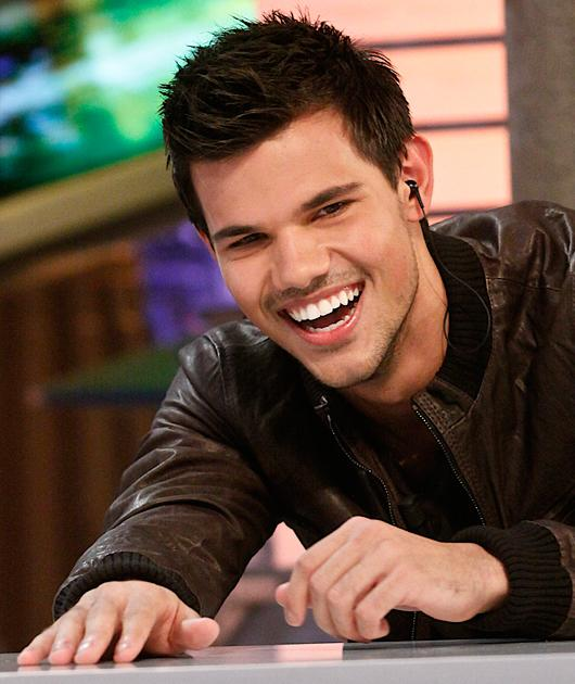 Taylor Lautner photos: Erm, how adorable is Taylor in this giggly shot?