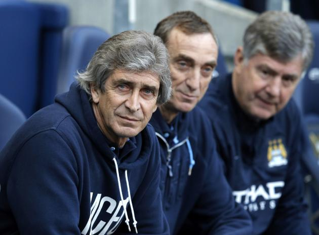 Manchester City's manager Pellegrini sits on the bench before their English FA Cup quarter final soccer match against Wigan Athletic in Manchester
