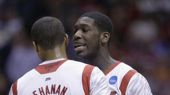 Louisville's Montrezl Harrell talks to teammate Chane Behanan (21) after Louisville guard Kevin Ware was injured during the first half of the Midwest Regional final against Duke in the NCAA college basketball tournament, Sunday, March 31, 2013, in Indianapolis. Louisville won 85-63 to advance to the Final Four. (AP Photo/Darron Cummings)