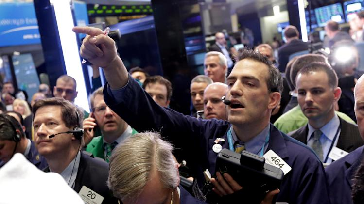 Trader Gregory Rowe calls out an order on the floor of the New York Stock Exchange Friday, April 19, 2013. The broad Standard & Poor's 500 index opened higher early Friday.  (AP Photo/Richard Drew)