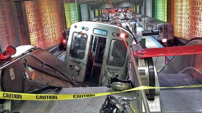 FILE - In this March 24, 2014 file photo, a Chicago Transit Authority train car rests on an escalator at the O'Hare Airport station after it derailed early in the morning, injuring more than 30 people, in Chicago. Had the crash occurred during the day, when the trains are often full and the escalator packed with luggage-carrying travelers, far more people likely would have been injured, some even killed, said Joseph Schwieterman, a transportation expert at DePaul University. (AP Photo/NBC Chicago, Kenneth Webster, File) MANDATORY CREDIT