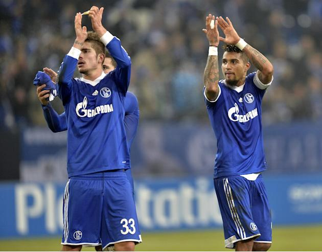 Schalke's Roman Neustaedter, left, and Kevin-Prince Boateng, right, applaud after the Champions League Group E soccer match between FC Schalke 04 and FC Basel in Gelsenkirchen, Germany, Wednesday,