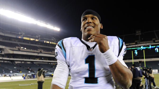 Carolina Panthers quarterback Cam Newton smiles as he walks off the field after an NFL football game against the Philadelphia Eagles, Monday, Nov. 26, 2012, in Philadelphia. Carolina won 30-22. (AP Photo/Michael Perez)