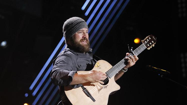 "FILE - In this June 9, 2011 file photo, Zac Brown of the Zac Brown Band performs during the CMA Fan Fest in Nashville, Tenn. The group's latest album, ""Uncaged,"" is scheduled for release on July 10. (AP Photo/Wade Payne, File)"