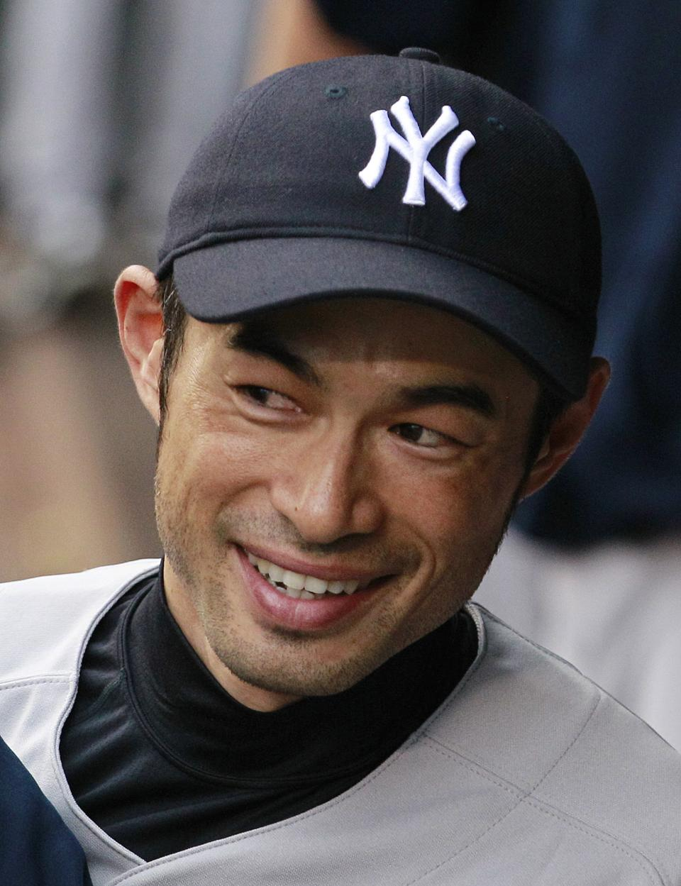 ALTERNATE CROP -- New York Yankees' Ichiro Suzuki smiles as he looks out of the dugout against the Seattle Mariners just before a baseball game Monday, July 23, 2012, in Seattle. The Yankees won 4-1. (AP Photo/Elaine Thompson)