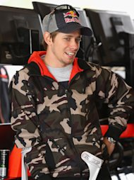 MELBOURNE, AUSTRALIA - SEPTEMBER 16: Australian MotoGP rider Casey Stoner looks on in the Team Vodafone garage during the warm up session for the Sandown 500, which is round 10 of the V8 Supercars Championship Series at Sandown International Motor Raceway on September 16, 2012 in Melbourne, Australia. Stoner was injured after a crash at the Indianapolis MotoGP and is currently recovering from ankle surgery. (Photo by Robert Cianflone/Getty Images)