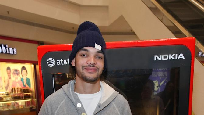 IMAGE DISTRIBUTED FOR NOKIA - Chicago Bulls center Joakim Noah shows off his new Nokia Lumia 920 at the Nokia Experience Center, during the Joakim Noah Nokia Mall Tour, on Thursday, Dec. 13, 2012 in Schaumburg, Ill. (Photo by Barry Brecheisen/Invision for Nokia/AP Images)