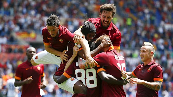 AS Roma's Doumbia celebrates with his teammates after scoring against Genoa during their Italian Serie A soccer match in Rome