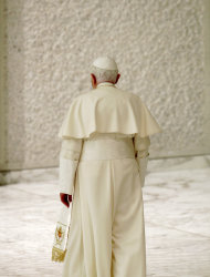 FILE - This Nov. 22, 2010 file photo shows Pope Benedict XVI leaving at the end of an audience with newly-appointed cardinals and their relatives, in Paul VI Hall, at the Vatican. On Monday, Feb. 11, 2013 the Vatican announced that Pope Benedict XVI will resign on Feb. 28, 2013. (AP Photo/Andrew Medichini)