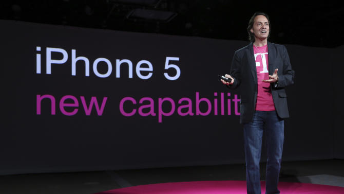 "T-Mobile CEO John Legere speaks during a news conference Tuesday, March 26, 2013 in New York. T-Mobile will start offering the iPhone 5 on April 12, filling what Legere said was ""a huge void"" in its phone lineup. The company is currently the only major U.S. carrier not to offer Apple's popular smartphone. (AP Photo/Mary Altaffer)"