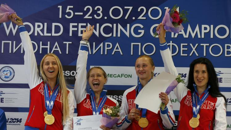 Team Russia Kolobova, Zvereva, Gudkova and Shutova pose with their gold medals for the women's team epee at the World Fencing Championships in Kazan