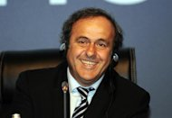 UEFA President Michel Platini smiles on March 22, 2012 during the opening of the annual UEFA Congress meeting, the official gathering of UEFA's 53 member associations, in Istanbul.  AFP PHOTO / BULENT KILIC