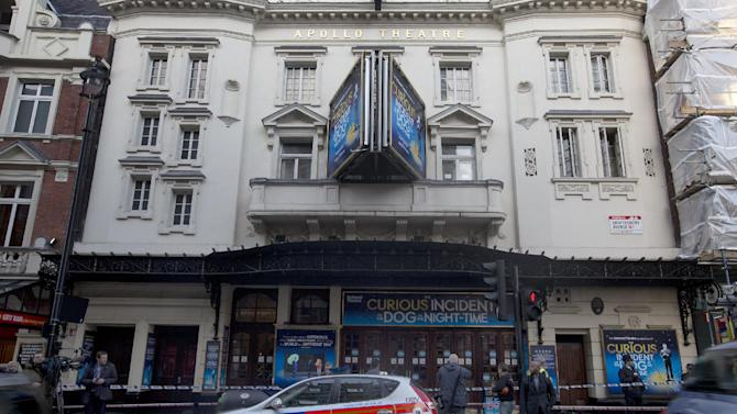 """Police stand outside The Apollo Theatre in London, Friday, Dec. 20, 2013. Authorities are carrying out a structural assessment at the Apollo Theatre after the partial collapse of its ceiling injured more than 75 people in the packed auditorium.An initial report is expected Friday after an overnight survey. The building remains cordoned off after the incident happened during the evening performance of """"The Curious Incident Of The Dog In The Nighttime."""" (AP Photo/Alastair Grant)"""
