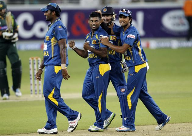Sri Lanka's Prasanna celebrates with his team mates the wicket of Pakistan's Akmal during their second Twenty20 international cricket match in Dubai