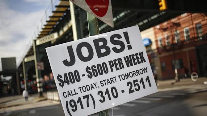 A sign advertising jobs is posted along a street in the Brooklyn borough of New York October 23, 2013.