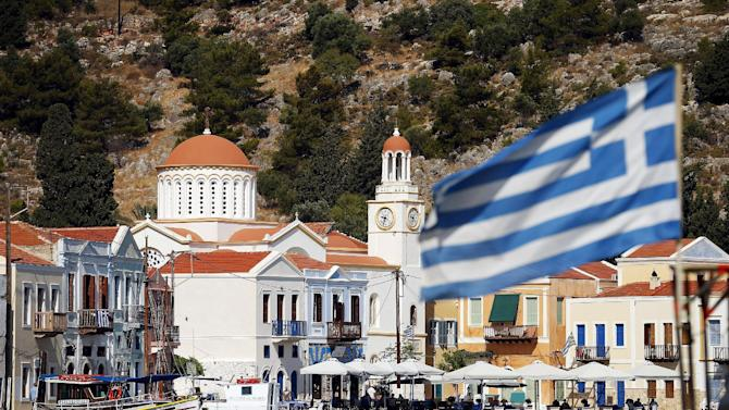 The Greek flag flutters in the village of Meyisti on the Island of Kastellorizo