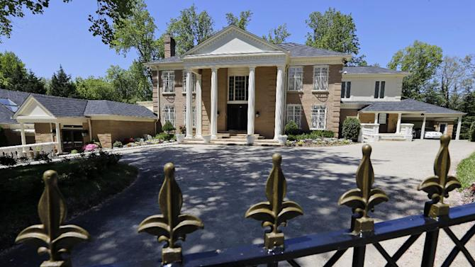 This house in McLean, Va., Thursday, May 2, 2013, owned by the government of Saudi Arabia, was investigated by the U.S. Immigration and Customs (ICE) officials on a report of human trafficking. An ICE official says agents went to the home in McLean on Tuesday night and removed the two possible victims of domestic servitude and Fairfax County police were called in to help. (AP Photo/Alex Brandon)