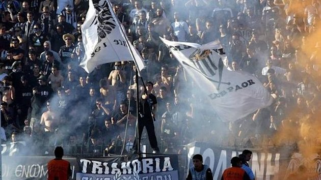 FOOTBALL PAOK Salonika fans celebrate beating Olympiakos in a Greek League play-off