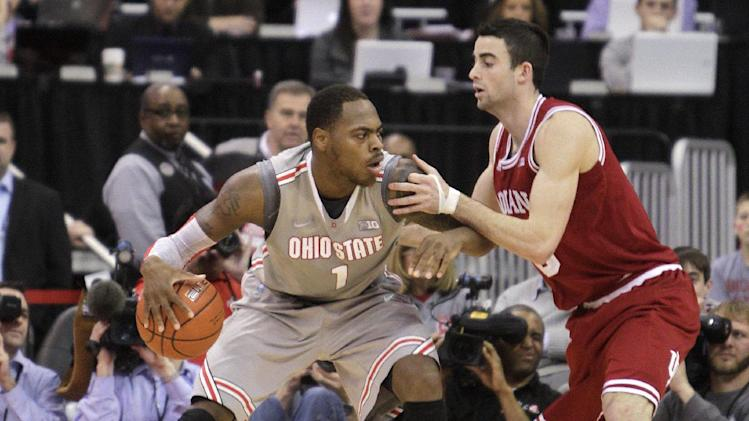 Ohio State's Deshaun Thomas, left, posts up against Indiana's Will Sheehy during the second half of an NCAA college basketball game on Sunday, Feb. 10, 2013, in Columbus, Ohio. Indiana defeated Ohio State 81-68. (AP Photo/Jay LaPrete)