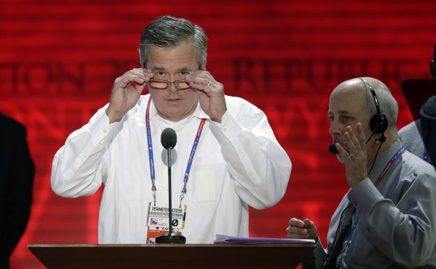 FILE In this Aug. 27, 2012 file photo, former Florida Gov. Jeb Bush looks at the convention floor from the podium during a microphone check at the Republican National Convention in Tampa, Fla. (AP Photo/J. Scott Applewhite, File)