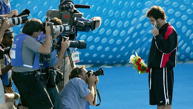Alexandre Despatie of Canada poses with his gold medal during the World Championships in Montreal