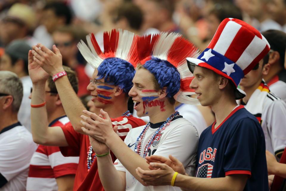 U.S.A. fans cheer their team during the second half of an international friendly soccer match against Germany at RFK Stadium, Sunday, June 2, 2013, in Washington. The U.S. won 4-3. (AP Photo/Alex Brandon)