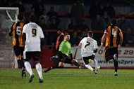 Leyton Orient's Dean Cox scores the second goal against Gloucester City