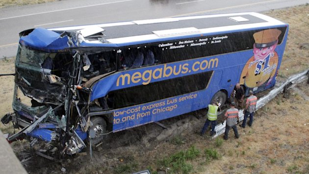 The wreckage of a Megabus is removed from the bridge support pilar that it slammed into after blowing a tire, Thursday, Aug. 2, 2012 in Litchfield, Ill. Illinois State Police Trooper Doug Francis said at least one person was killed in the afternoon wreck which was traveling from Chicago to Kansas City. He didn&#39;t immediately have other details about the death. (AP Photo/Tom Gannam)