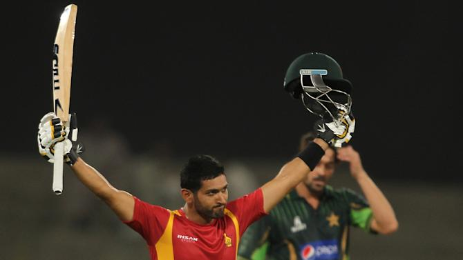 Zimbabwe's Sikandar Raza celebrates his century against Pakistan during the second one-day international at the Gaddafi stadium in Lahore, Pakistan, Friday, May 29, 2015. (AP Photo/K.M. Chaudary)