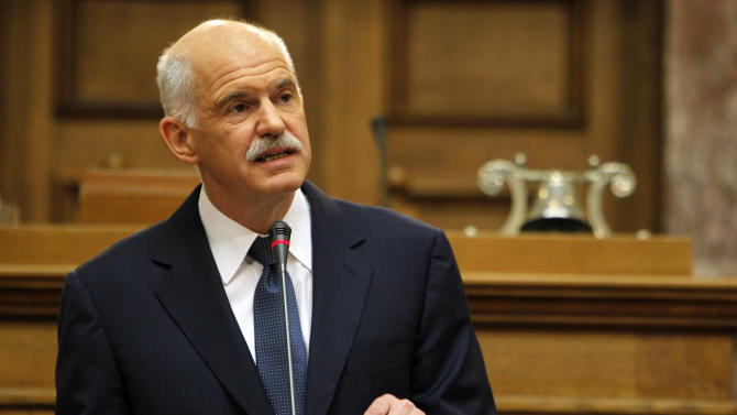 Greek Prime Minister George Papandreou addresses Socialist members of parliament in Athens, Monday, Oct. 31, 2011. Papandreou says his country will hold a referendum on a new European debt deal reached last week. Papandreou gave no date on other details of a proposed referendum on the deal that aims to seek 50 percent losses for private holders of Greek bonds and provide the troubled eurozone member with euro 100 billion ($140 billion) in additional rescue loans. (AP Photo/Thanassis Stavrakis)