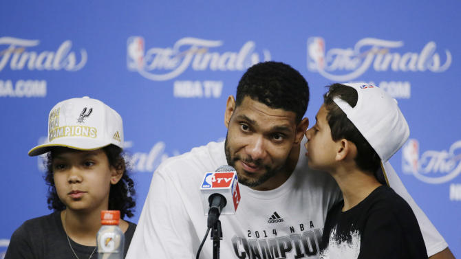 San Antonio Spurs forward Tim Duncan center, is joined by his daughter Sydney, left, and son Draven, right, during a news conference after Game 5 of the NBA basketball finals against the Miami Heat on Sunday, June 15, 2014, in San Antonio. The Spurs won the NBA championship 104-87. (AP Photo/Tony Gutierrez)