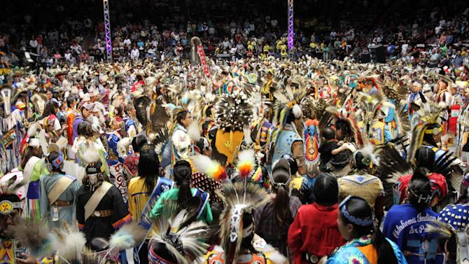 Hundreds of Native American and indigenous dancers pour onto the floor at University of New Mexico Arena for the grand entry during the 29th Annual Gathering of Nations in Albuquerque, N.M., on Friday, April 27, 2012. The three-day event draws more than 3,000 dancers and singers and tens of thousands of spectators. (AP Photo/Susan Montoya Bryan)