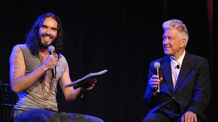 COMMERCIAL IMAGE - Russell Brand, left, and David Lynch speak onstage at the David Lynch Foundation:  A Night of Comedy honoring George Shapiro at the Beverly Wilshire Hotel on Saturday June 30, 2012 in Beverly Hills, Calif. (Photo by John Shearer/Invision for David Lynch Foundation/AP Images)