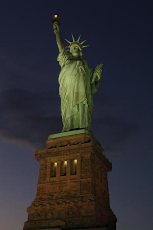 In this photo provided by the National Park Service, the Statue of Liberty is illuminated for the first time since it was damaged by Superstorm Sandy, Friday evening, Nov. 9, 2012. The statue, one of the city's top tourist attractions, has been closed because of damage resulting from the storm that hit New York Oct. 29, with no estimate on when it will reopen to visitors. (AP Photo/National Park Service, Mike Litterst) MANDATORY CREDIT