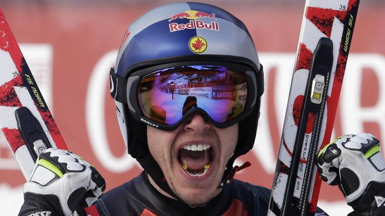 Guay reacts after crossing the finish line to win the men's World Cup Downhill skiing race in Val Gardena
