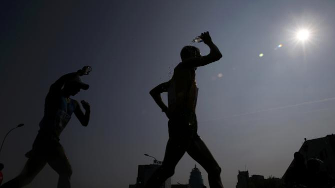 Athletes compete in the men's 50 km race walk final during the 15th IAAF World Championships on the streets Beijing